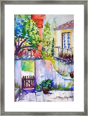 Courtyard In Sintra Framed Print by Nancy Brennand