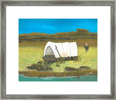 Covered Wagon Framed Print by Donna Leach