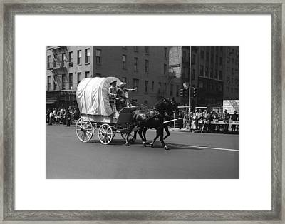 Covered Wagon On Street During Parade Framed Print by George Marks