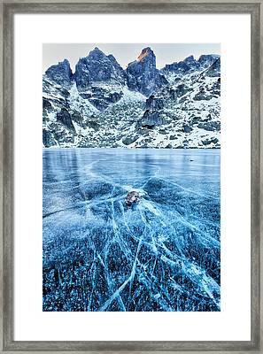 Cracks In The Ice Framed Print by Evgeni Dinev