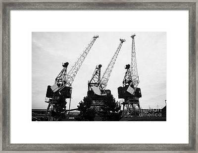 Cranes At Leith Docks Edinburgh Scotland Framed Print by Joe Fox