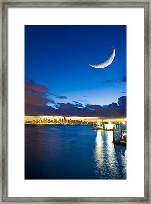 Crescent Moon Over Vancouver Framed Print by David Nunuk
