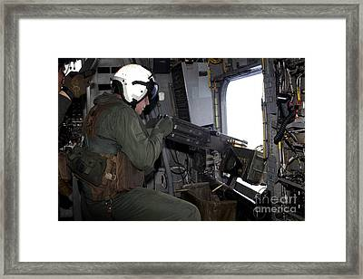 Crew Chief Fires An M2 .50-caliber Framed Print by Stocktrek Images