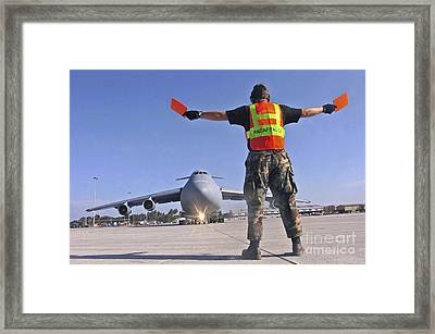 Crew Chief Marshals A C-5 Galaxy Framed Print by Stocktrek Images