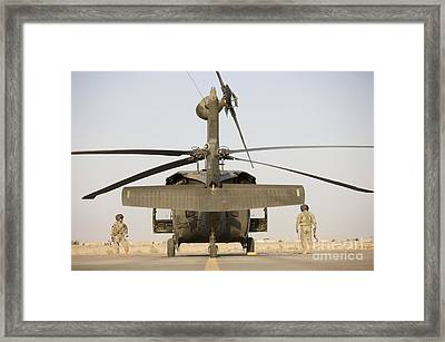 Crew Chiefs Stand Beside Their Uh-60l Framed Print