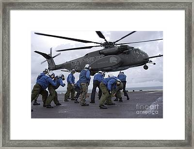 Crew Members Brace Themselves As An Framed Print by Stocktrek Images