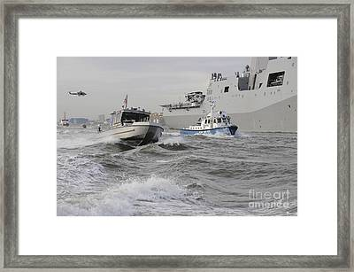 Crews From The Coast Guard And Police Framed Print