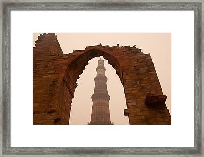 Cross Section Of The Qutub Minar Framed Within An Archway In Foggy Weather Framed Print