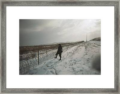Crossing The Line Framed Print by Brian Rock
