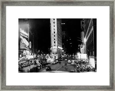 Crowds In Times Square Await Framed Print by Everett