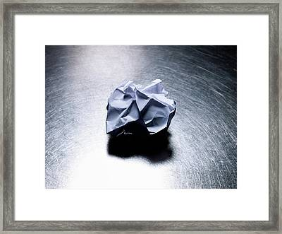 Crumpled Sheet Of White Paper On Stainless Steel. Framed Print by Ballyscanlon