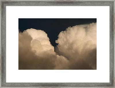 Cumulus Clashers Framed Print