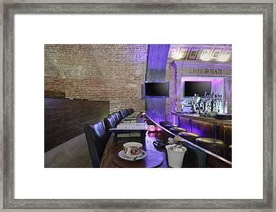 Cup Of Tea On Long Restaurant Table Framed Print by Magomed Magomedagaev