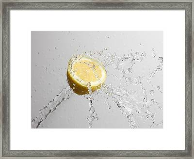 Cut Lemon Splashed With Water Framed Print by Vincenzo Lombardo