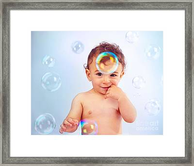 Cute Baby Boy Playing With Soap Bubbles Framed Print by Anna Om