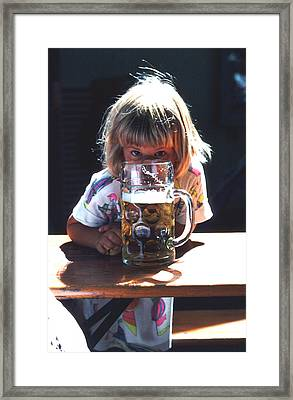 Framed Print featuring the photograph Cute Little Girl At Beer Garden Munich by Tom Wurl