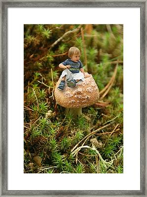 Cute Tiny Boy Sitting On A Mushroom Framed Print by Jaroslaw Grudzinski
