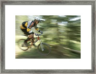 Cycling On Stoner Mesa, Colorado Framed Print by Bill Hatcher