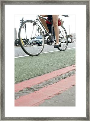 Cyclist In A Cycle Lane Framed Print by Tony Mcconnell