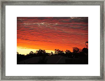 Dakabin Red Framed Print by Peter Lombard