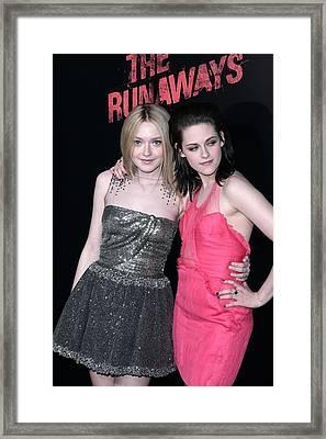 Dakota Fanning, Kristen Stewart Framed Print by Everett