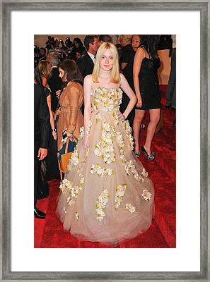 Dakota Fanning Wearing A Dress Framed Print
