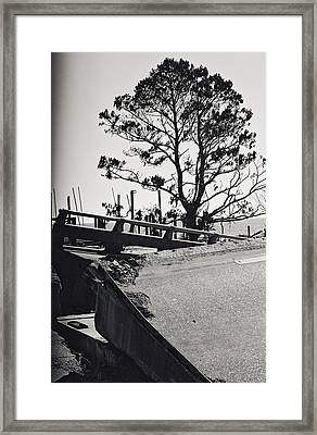 Damaged Bridge Framed Print by Floyd Smith