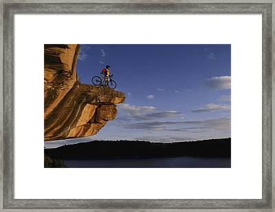 Dan Davis Takes In The View Framed Print by Bill Hatcher