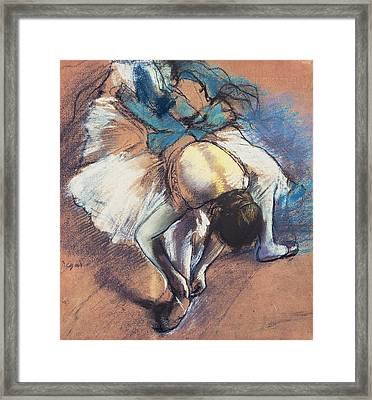 Dancer Fastening Her Pump Framed Print by Edgar Degas