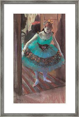 Dancer Leaving Her Dressing Room Framed Print by Edgar Degas