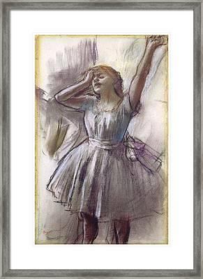 Dancer Stretching Framed Print by Edgar Degas