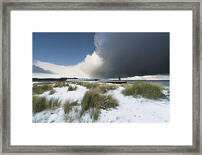 Dark Clouds And Blue Sky Over A Red Framed Print by John Short