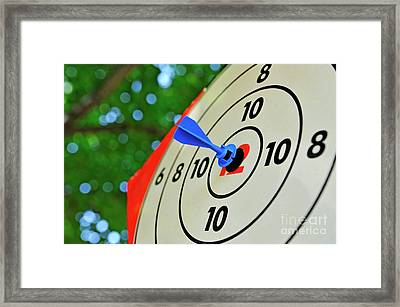Dart In The Middle Of A Target Framed Print by Sami Sarkis