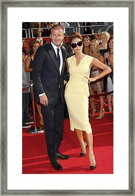 David Beckham, Victoria Beckham Wearing Framed Print by Everett