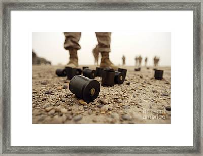 Dented Primers And Empty Shells Framed Print by Stocktrek Images