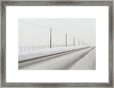 Desolate Winter Road Framed Print by Lynn Koenig