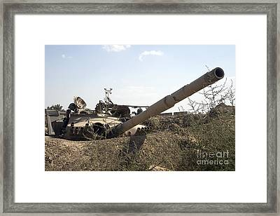 Destroyed Iraqi Tanks Near Camp Slayer Framed Print by Terry Moore