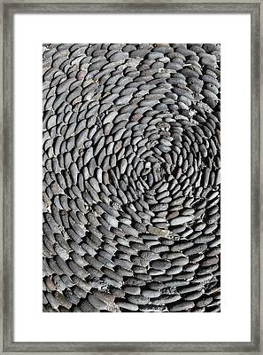 Detail Of Stones Arranged In A Pattern On The Ground Framed Print by Marc Volk