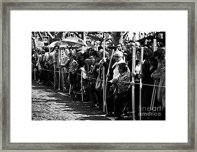 Devotees Framed Print by Gaspar Avila