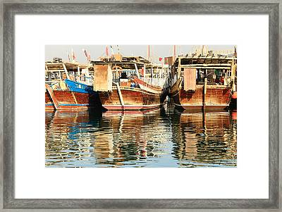 Dhow Reflections Framed Print by Paul Cowan