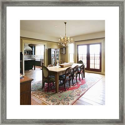 Dining Room Table On A Rug Framed Print