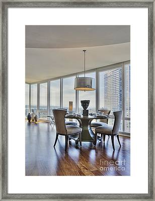 Dining Table And Chairs With City View Framed Print by Andersen Ross