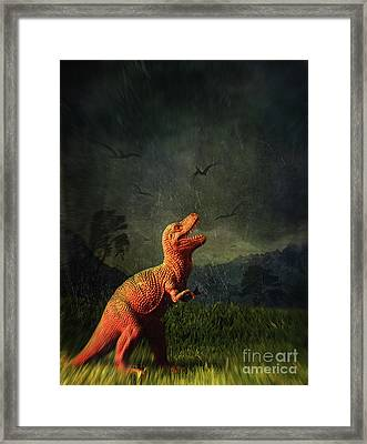 Dinosaur Toy Figure In Surreal Landscape Framed Print by Sandra Cunningham