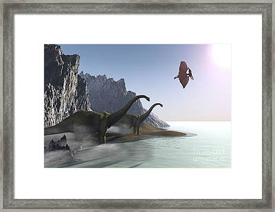 Dinosaurs Come To The Shore For A Drink Framed Print