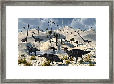 Dinosaurs Gather At A Life Saving Oasis Framed Print by Mark Stevenson