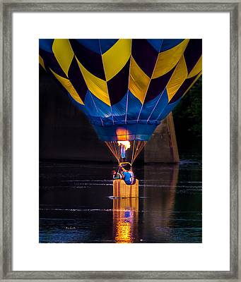 Dipping The Balloon Basket Framed Print by Bob Orsillo