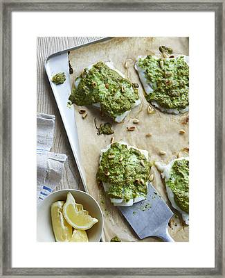 Dish Of Rocket Pesto Fish With Lemon Framed Print by Cultura/BRETT STEVENS