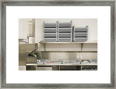 Dish Washing Area In A Commercial Kitchen Framed Print by Andersen Ross