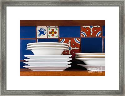 Dishes In Front Of Colorful Tile Framed Print by Thom Gourley/Flatbread Images, LLC