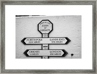 distance signs at the first and last shop John OGroats scotland uk Framed Print by Joe Fox
